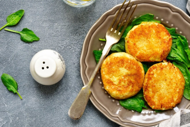 These easy-to-make Crispy Cheesy Cauliflower Fritters are reminiscent of traditional potato latkas, minus the belly-bloating carbs. Get the recipe!
